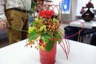 Small floral arrangement with a unique shape vase